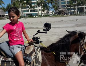 RUN fX mounted on a saddle at Acapulco beach