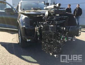 QUBE stabilized camera head mounted at the front of a VW Touareg